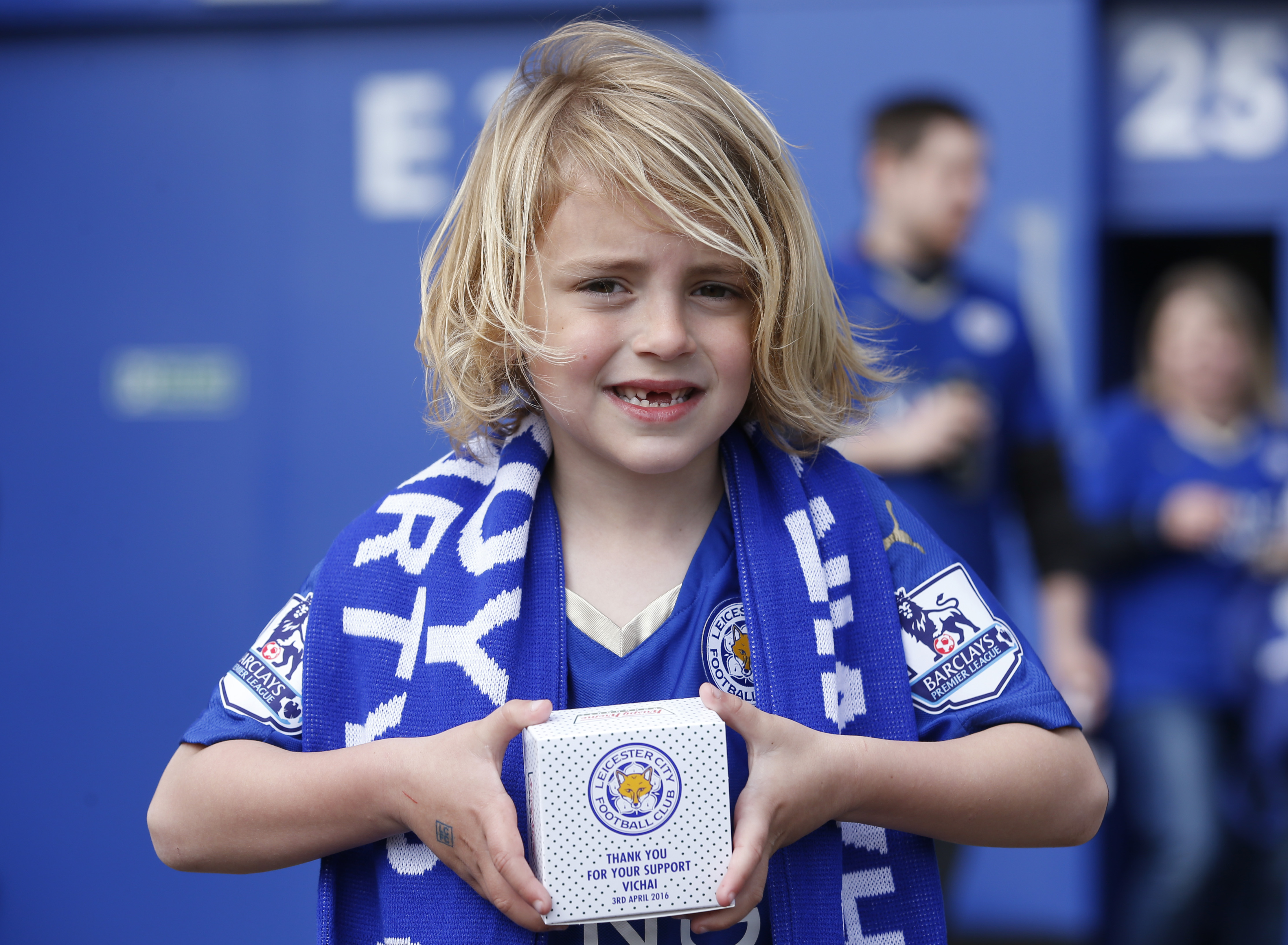 "Football Soccer - Leicester City v Southampton - Barclays Premier League - The King Power Stadium - 3/4/16 Leicester fan poses with a Leicester City doughnut outside the ground before the game Action Images via Reuters / Carl Recine Livepic EDITORIAL USE ONLY. No use with unauthorized audio, video, data, fixture lists, club/league logos or ""live"" services. Online in-match use limited to 45 images, no video emulation. No use in betting, games or single club/league/player publications. Please contact your account representative for further details. - RTSDCDJ"